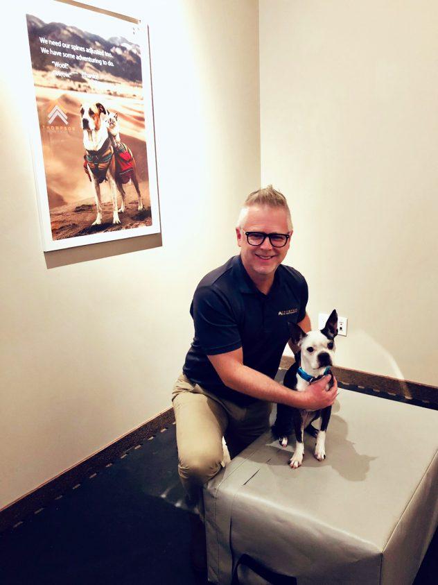 DR BRENT THOMPSON ADJUSTING NIJA THE DOG.